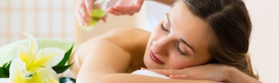 woman having wellness back massage in spa